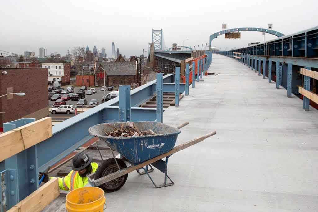 Construction worker with a wheelbarrow working on a pedestrian access to the bridge. Photo courtesy of Reddit.