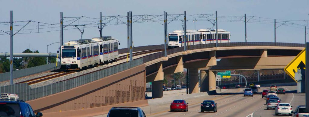 LRT Trains on the flyover bridge next to I-225