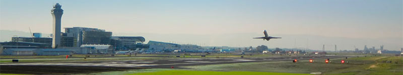 Portland International Airport with airplane taking off
